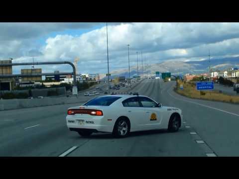 Utah highway patrol officer performs a slow-down (traffic break) maneuver